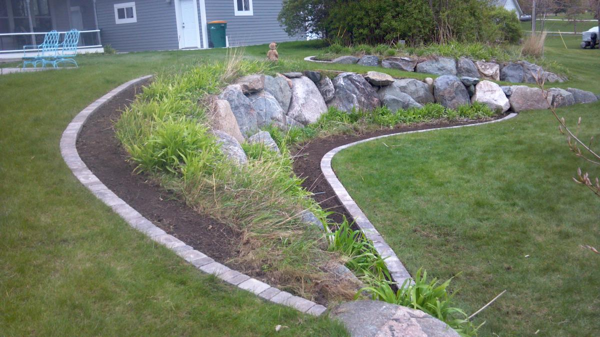 Landscaping Boulders Mn : Boulders are used as an accent to create dimension the landscape